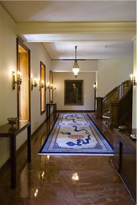 Entrance to the Council Chamber of the Universal House of Justice. A painting of 'Abdu'l-Baha is at the end of the hall.